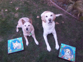 Two dogs posing with their RobiniArt portraits